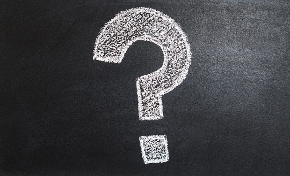 Image of a question mark on a chalkboard.