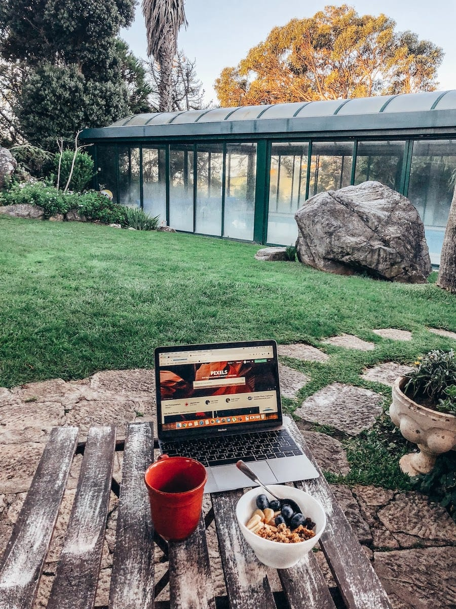 image of working outdoors with fruit in an exotic location.