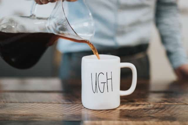 Coffee in an 'ugh' mug.