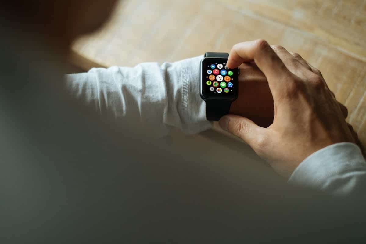 Person using Apple Watch interface.