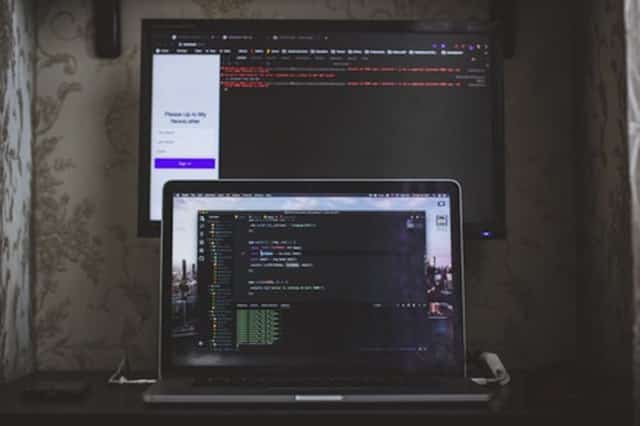 """""""MacBook Pro with coding on the screen"""