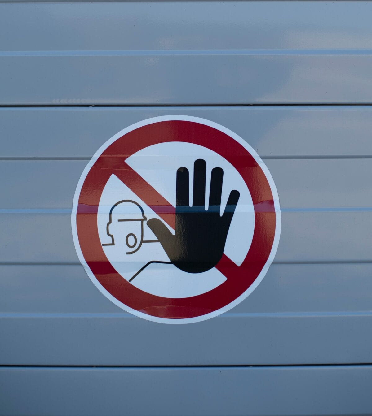 Sign displaying a hand indicating to stop.