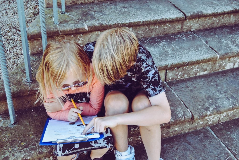 Two kids learning together.