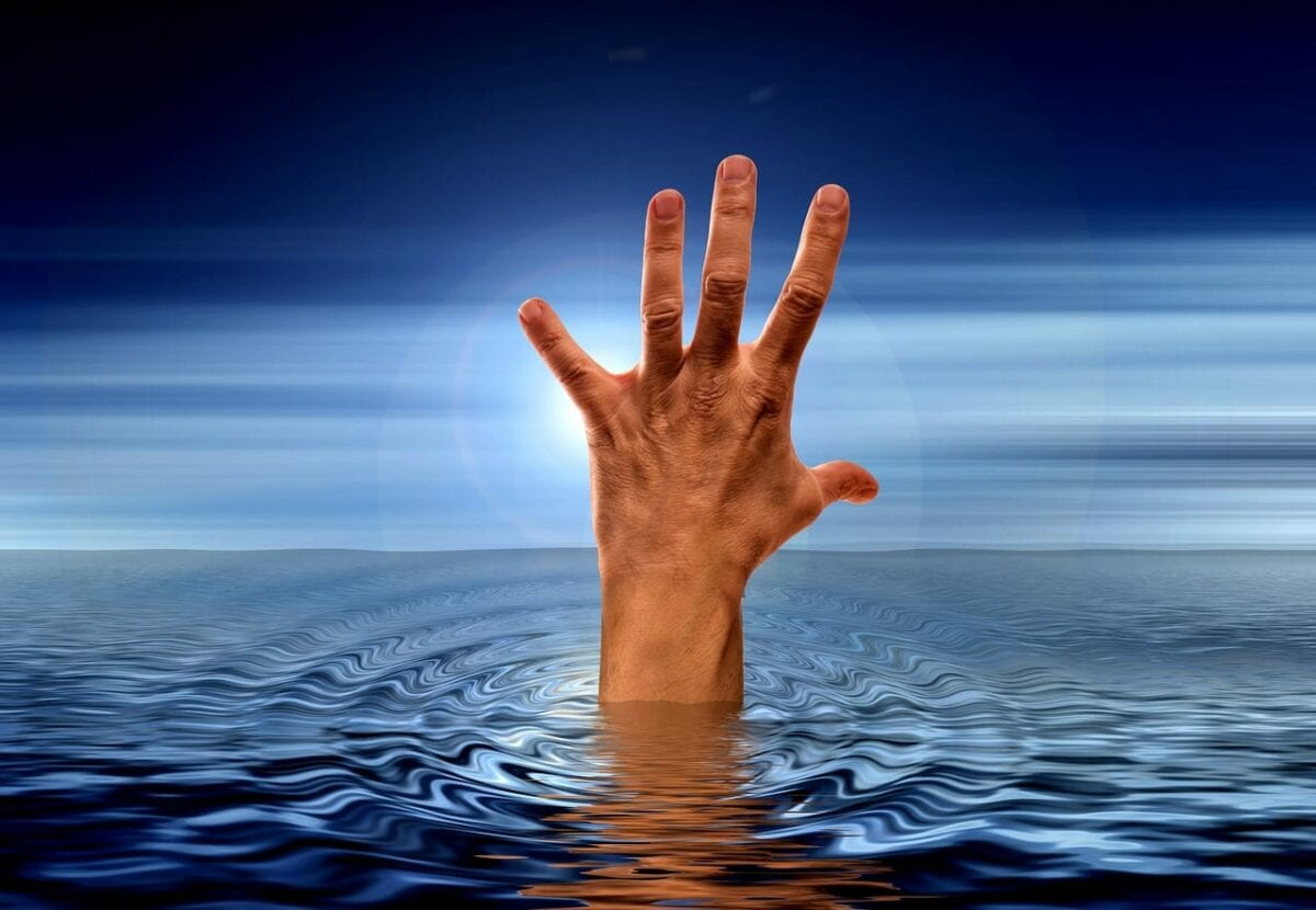 hand reaching out of water, to symbolize code newbies reaching out of tutorial purgatory