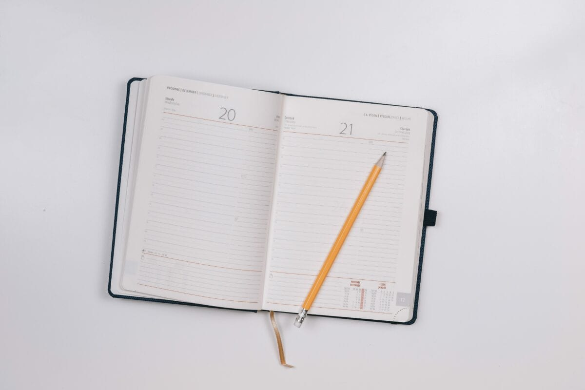 Image of a planner and pencil