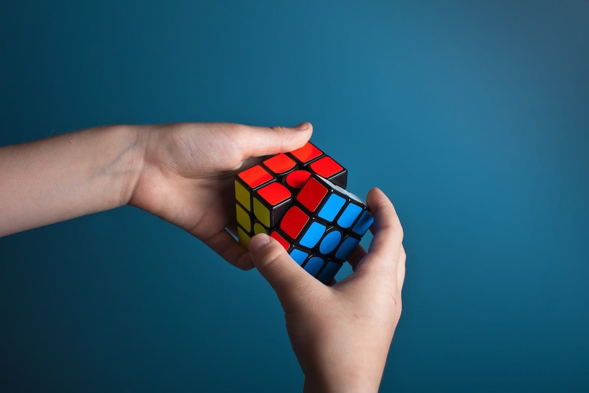 A person solving a Rubik's Cube