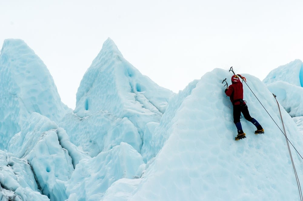 Man climbing a snowy mountain.