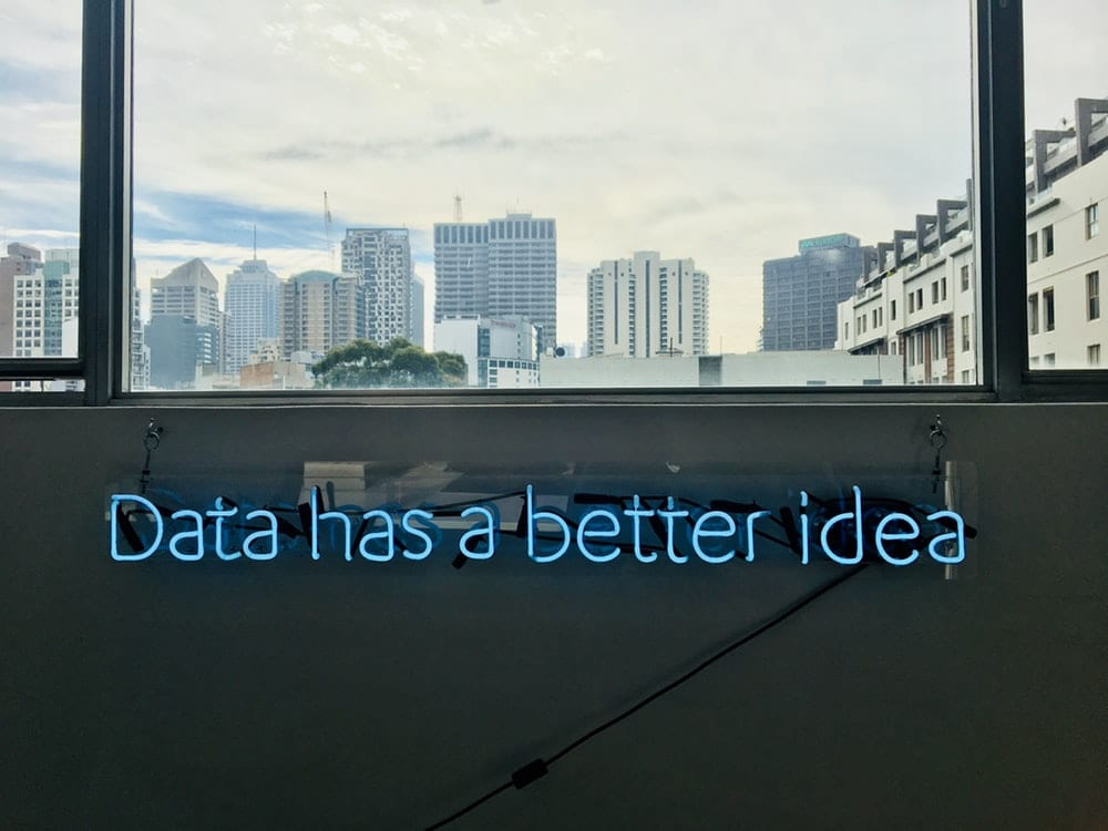 "white building with ""data has a better idea"" text signage"