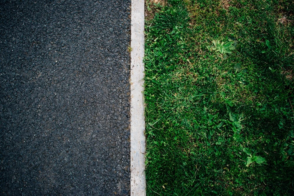 Asphalt and green grass
