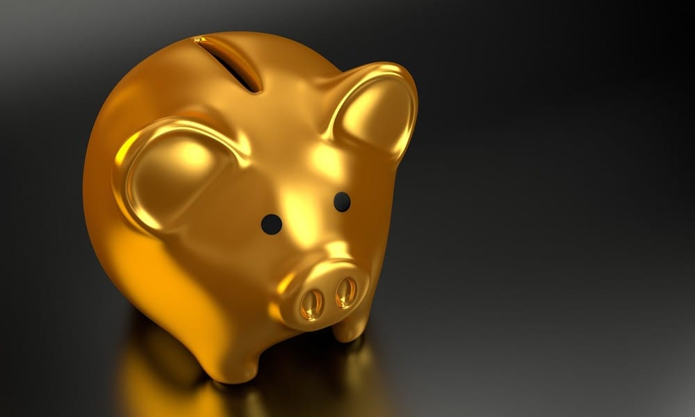 Financial literacy education will help keep piggy banks like this gold one full.
