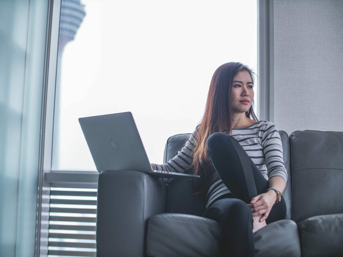 woman thinking about how to pay for coding bootcamp