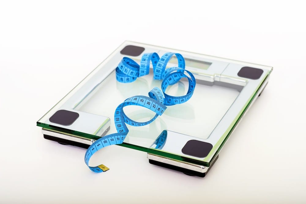 Blue Tape Measuring On Clear Glass Square Weighing Scale 53404