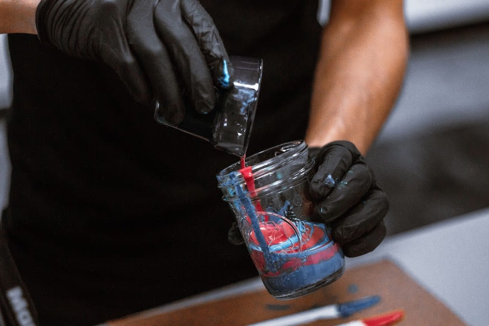 Photo Of Person Combining Acrylic Paints In Mason Jar 2471215