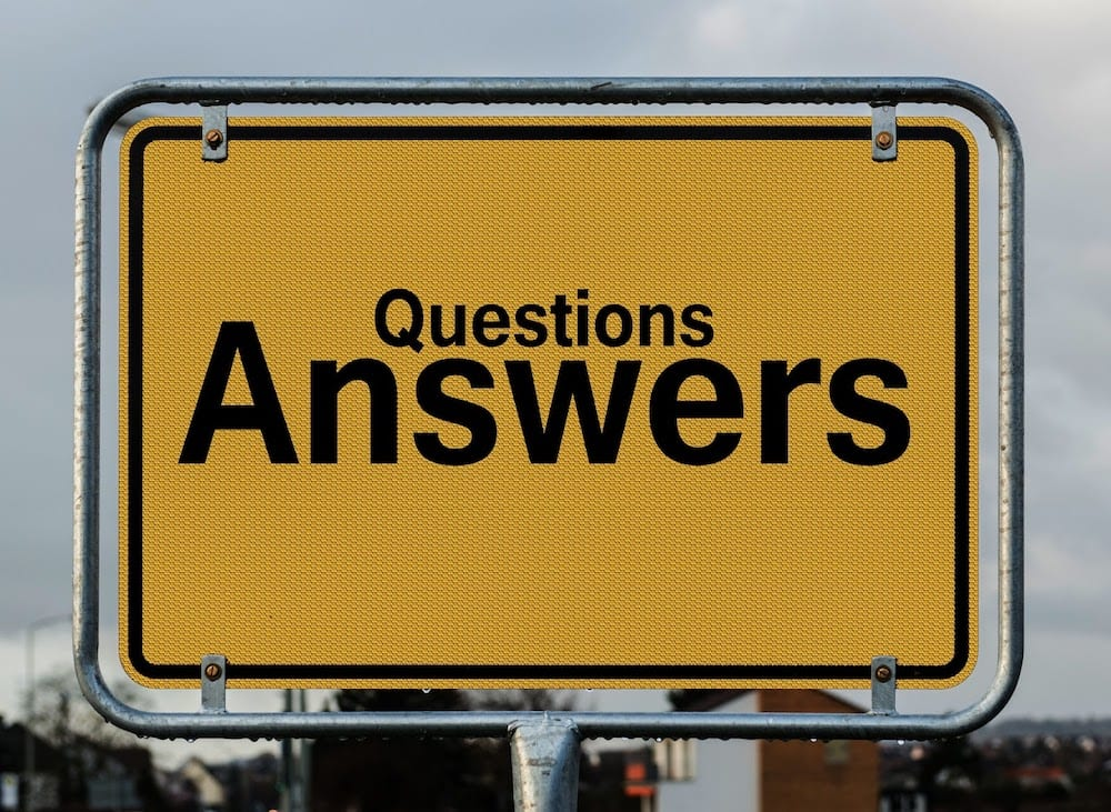 "A sign with the words ""Questions"" and ""Answers"""