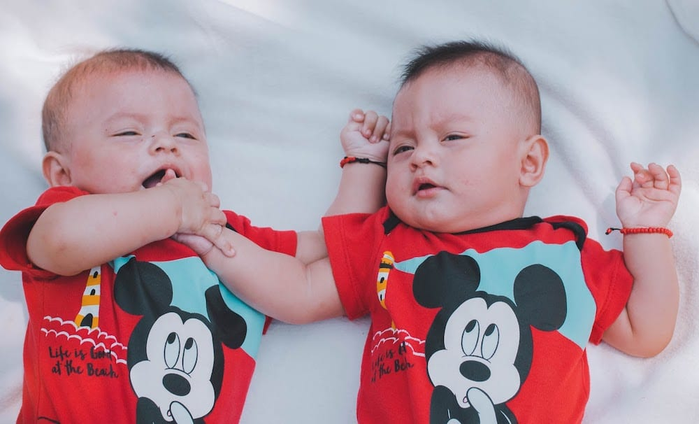 Two Babies Wearing Red Mickey Mouse Shirts 2132663