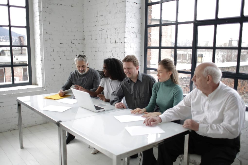 Five people in a meeting