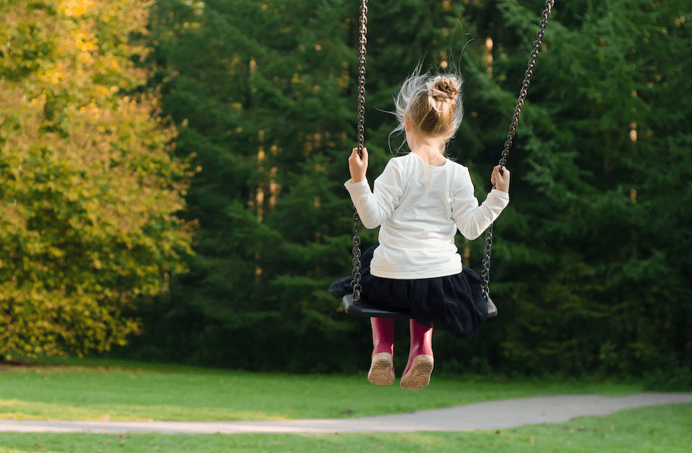 A girl on a swing.