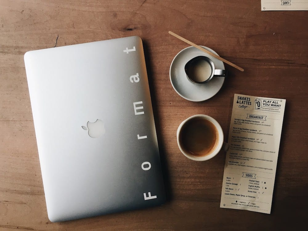Photo Of Macbook Near Cup And Saucer 1029140