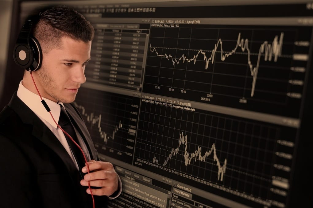 man looking at stock chart