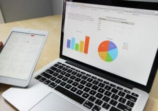 A laptop showing graphs and charts
