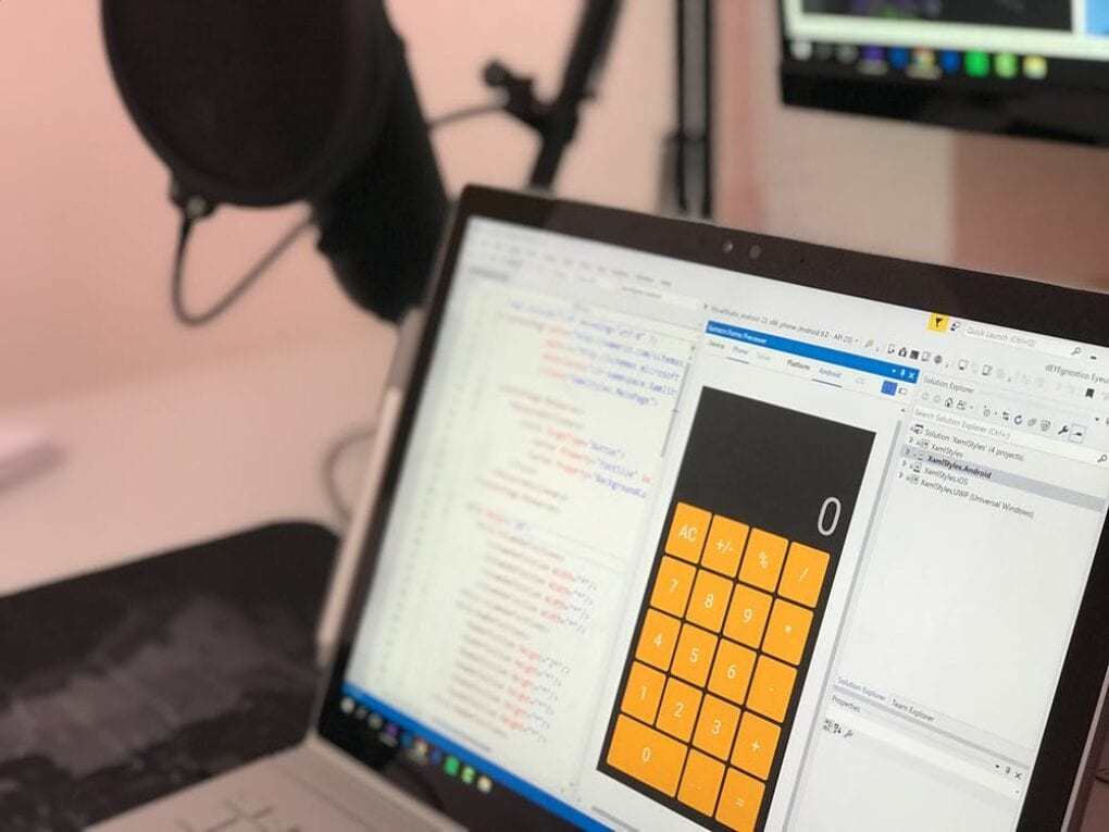 A laptop screen with a calculator and HTML script
