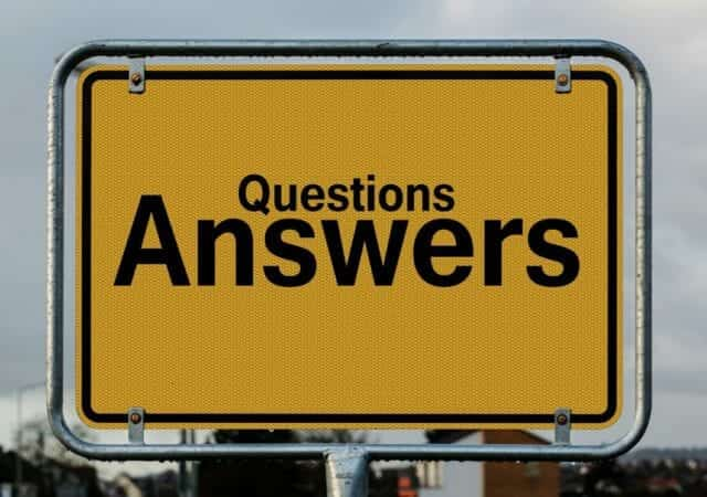 """A sign reads """"questions, answers"""""""
