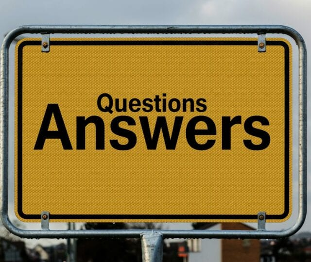 "A sign reads ""questions, answers"""