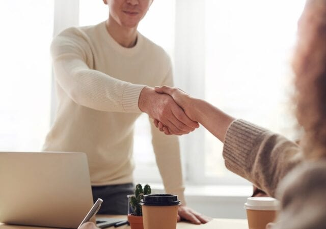 a man shaking hands with a recruiter
