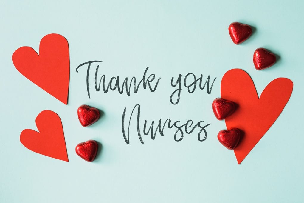 A gratitude message for nurses surrounded by red hearts.