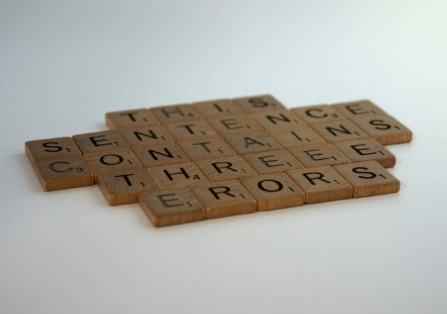 Scrabble Letters Form Sentence Containing Errors