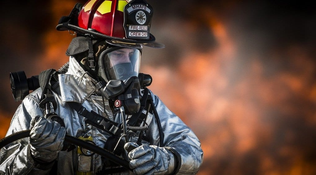 A firefighter trying to put out a fire