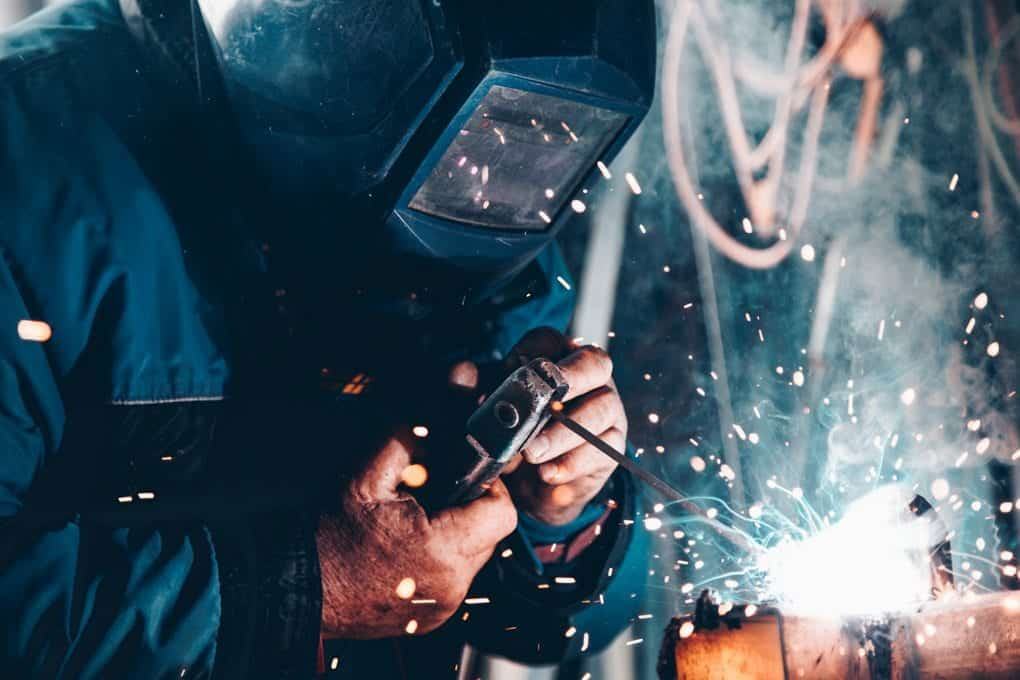 a welder using their vocational skills to burn some metal
