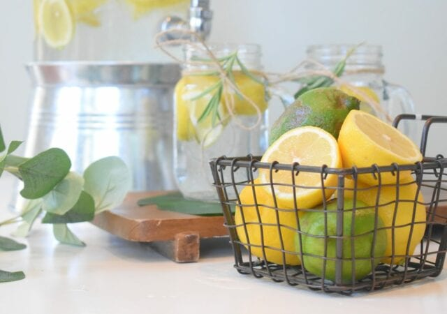 Lemons and limes with refreshing glasses of lemonade