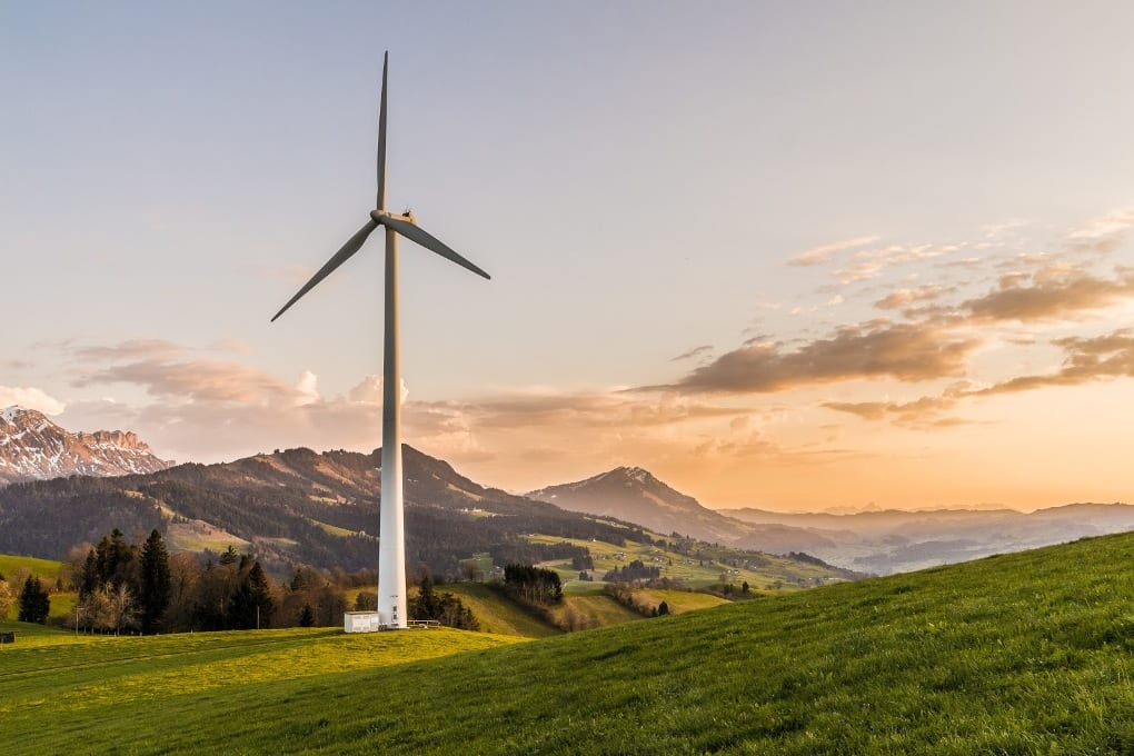 white wind energy in the green countryside