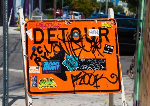 Detour Sign with Graffiti