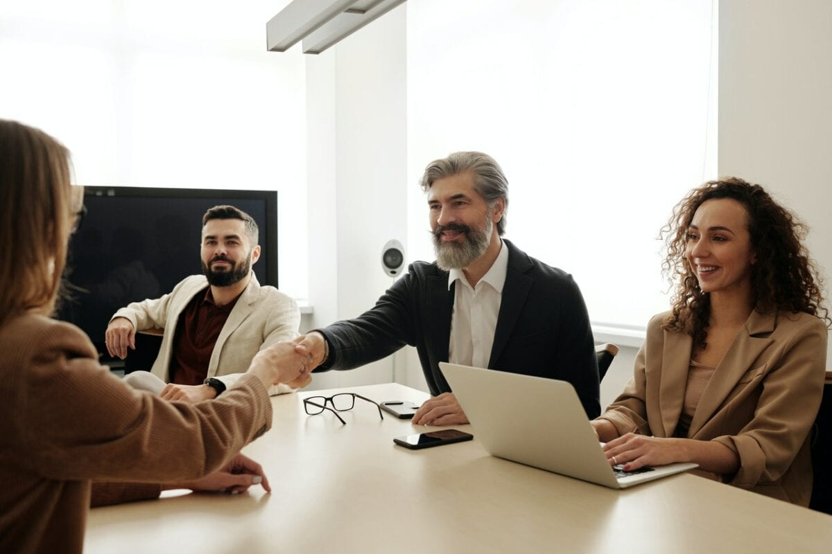man shaking other person's hand