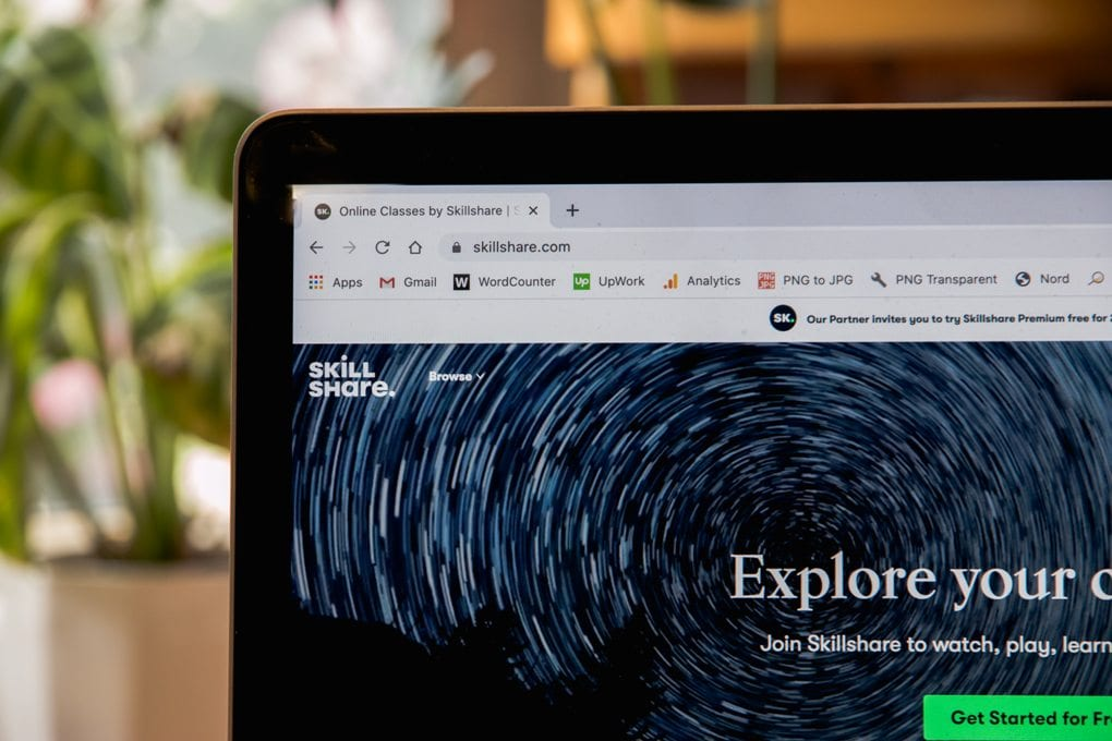 a black laptop with the Skillshare website home page