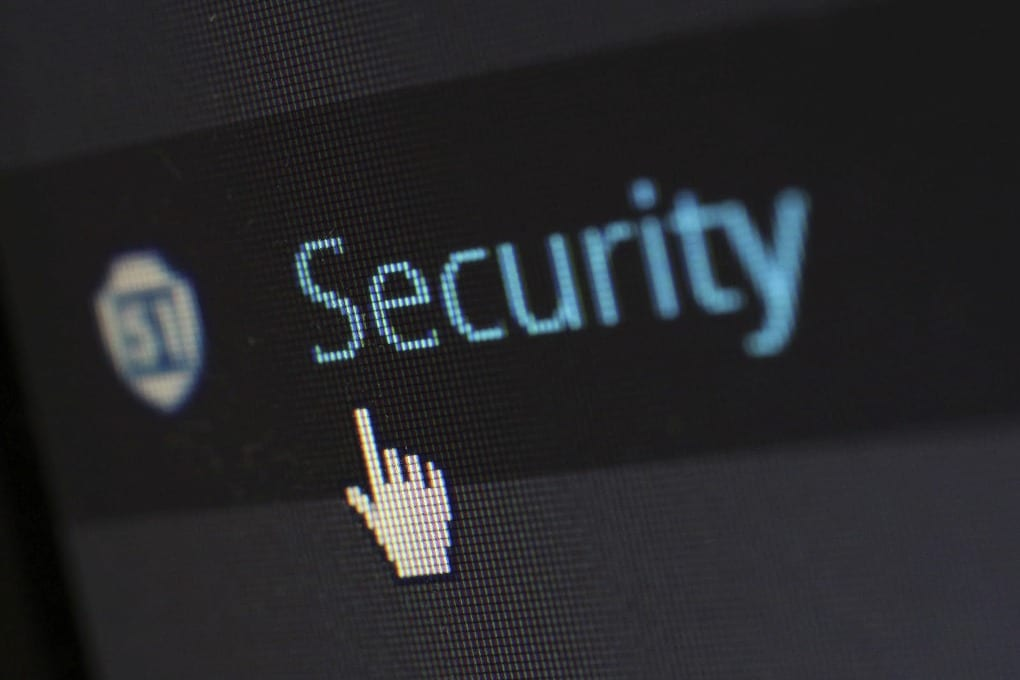 a computer text reads the word security