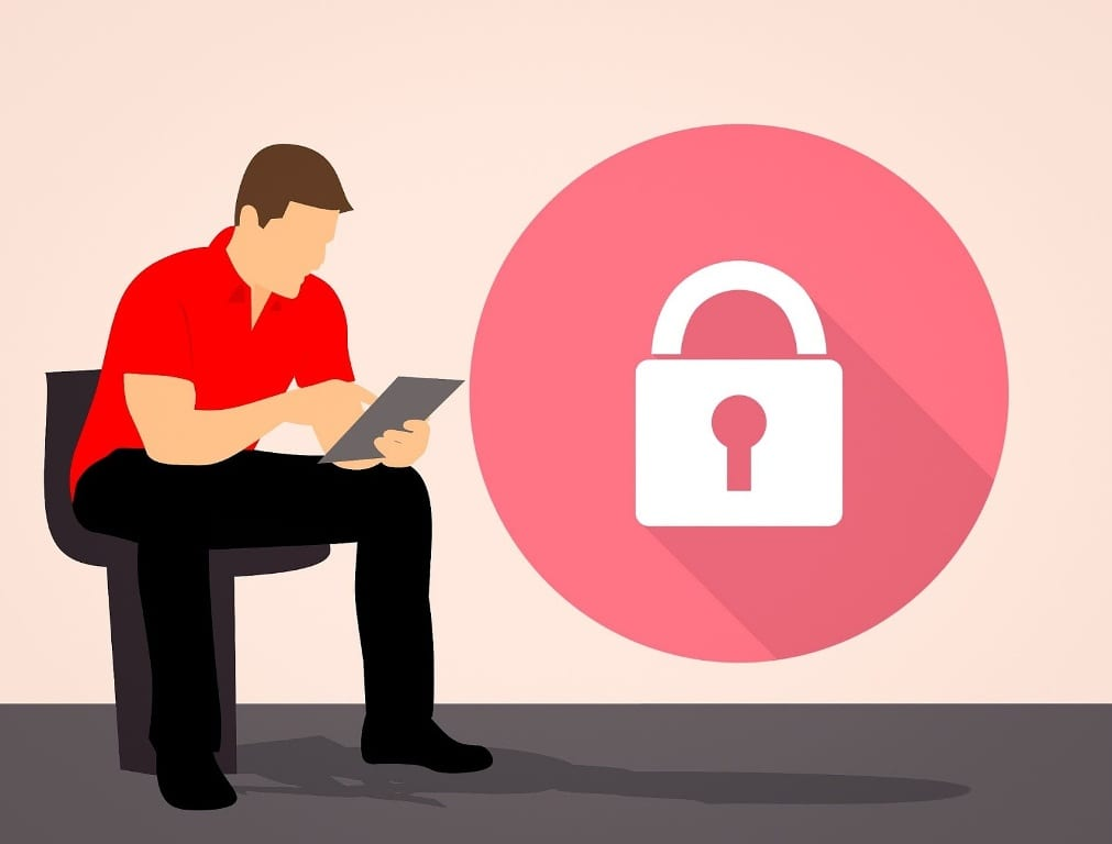 An illustration of a seated man using a tablet, with a lock in a red circle floating to our right.