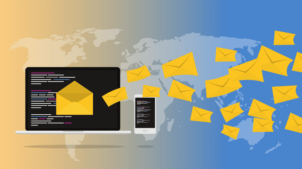 Yellow mail envelopes coming out of a laptop screen on the backdrop of the world atlas.