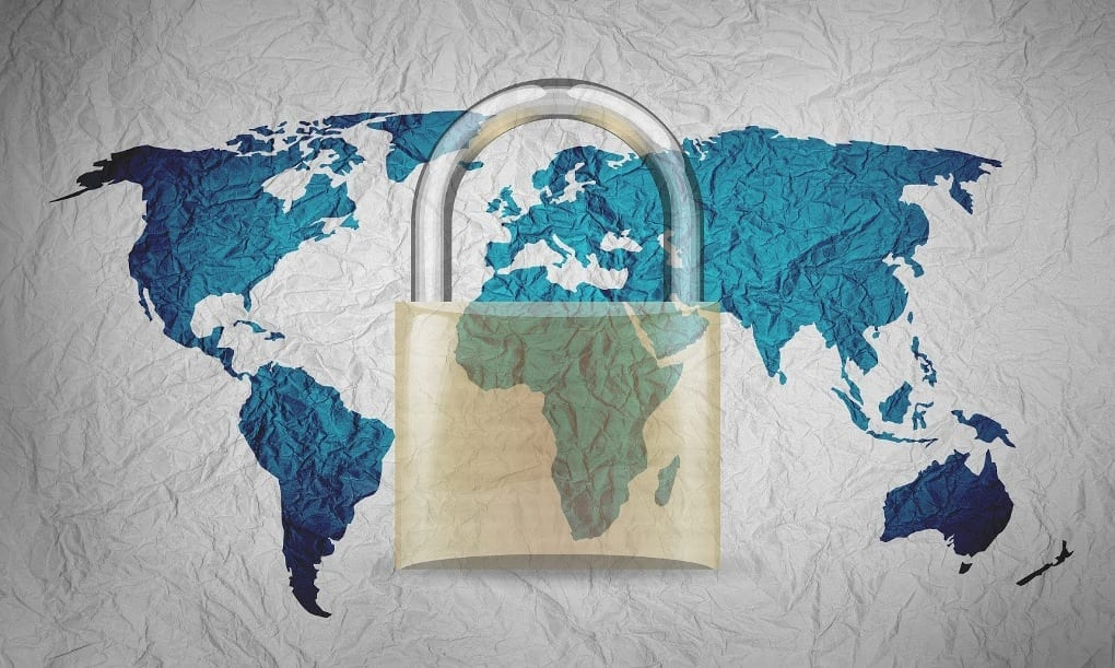 Two-dimensional map of the world on crumpled paper, with all of the continents in blue and the oceans in white, overlaid with an image of a translucent gold padlock.