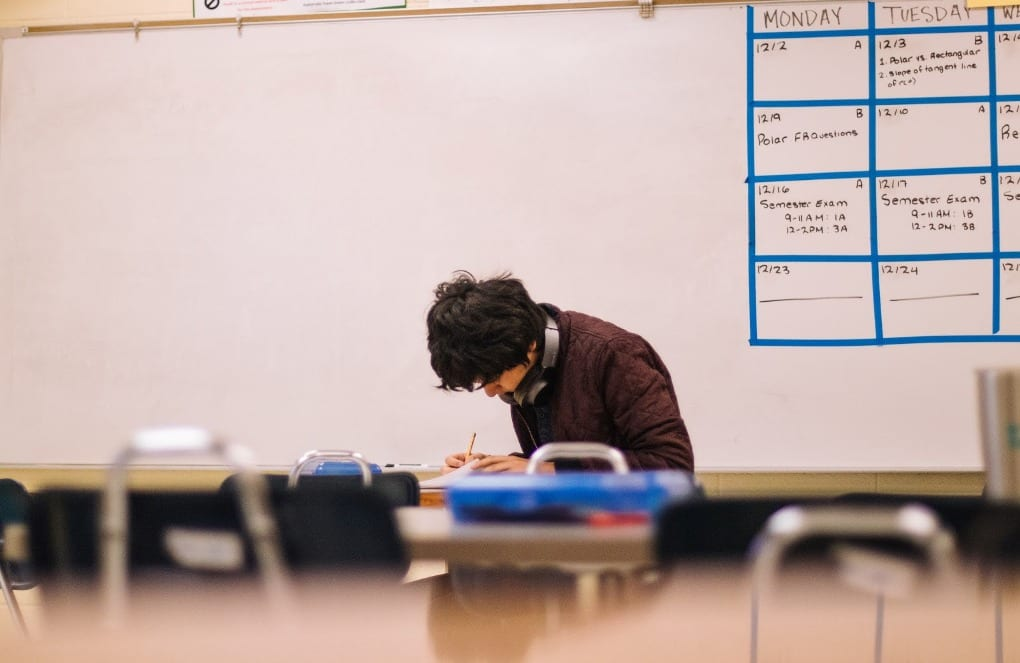 A student taking an exam in the classroom