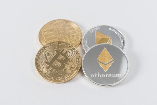 Pieces of Ethereum and Bitcoin sitting side by side.