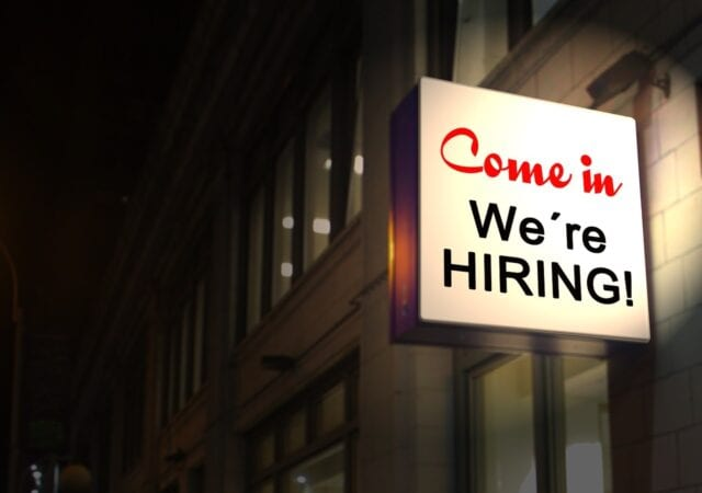 A neon sign that says Come in We're HIRING!