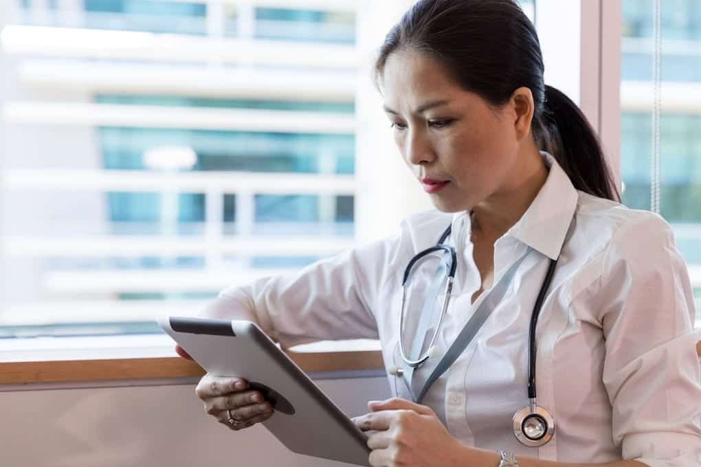 a health worker holding a tablet