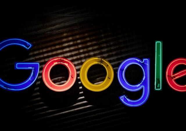 Closeup of the Google logo in neon lights