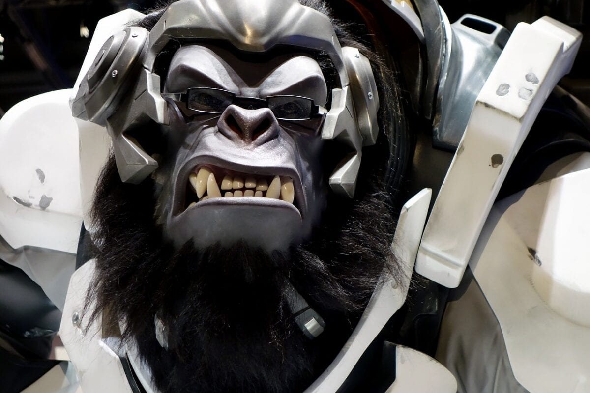 A closeup of a sculpture of Winston, a character from the Overwatch series of games developed by Blizzard. Winston is a gorilla in a suit of power armor that wears glasses.