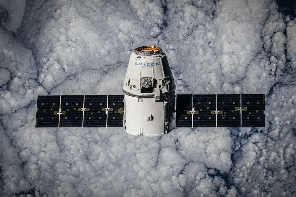 a spacecraft against a cloud-like background