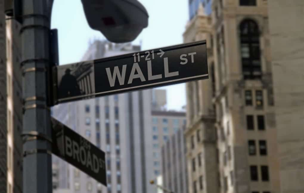 Street signs showing the intersection of Wall Street and Broad Street in New York City.