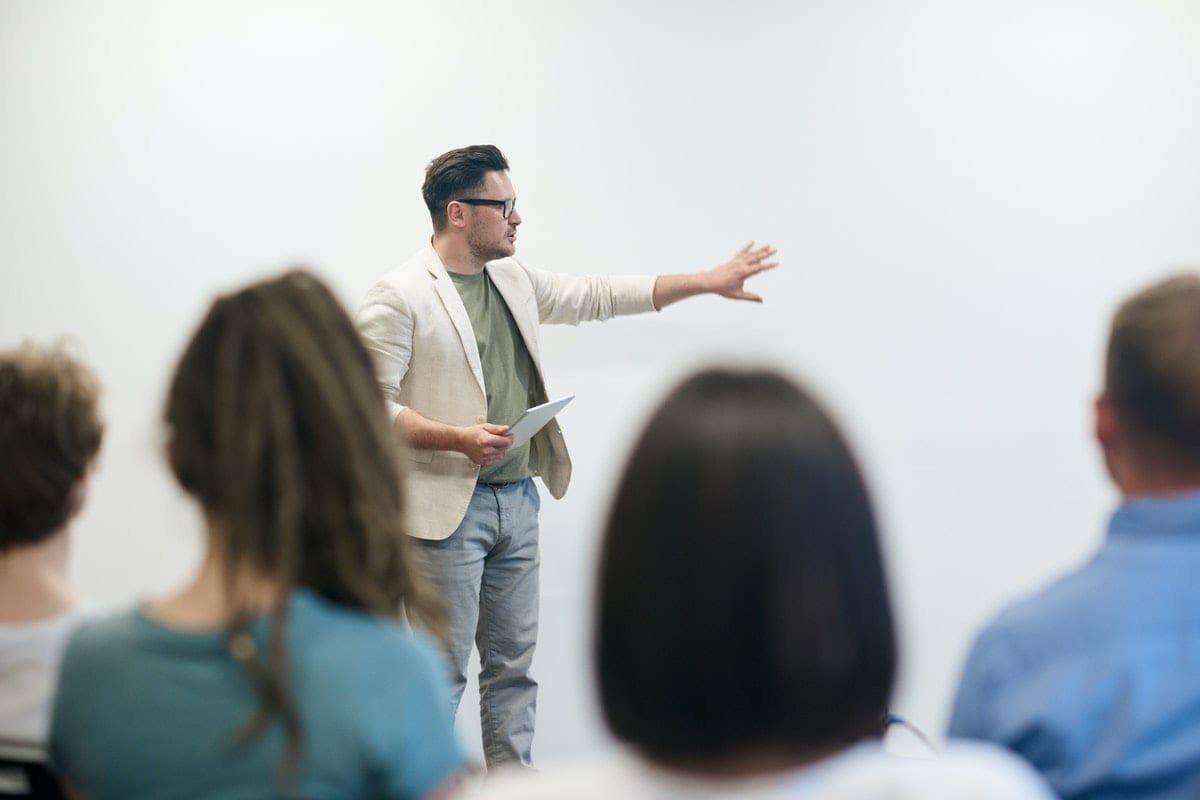 a man presenting in front of audience